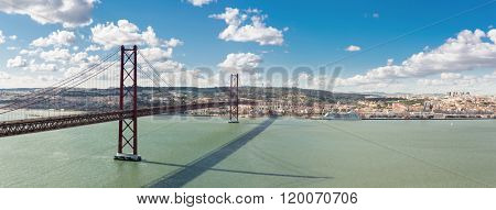 Panorama of Lisbon cityscape with 25 de Abril suspension Bridge, Portugal