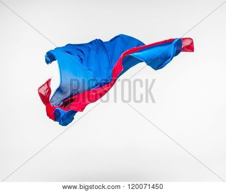 abstract pieces of blue and red fabric flying, studio shot, design element