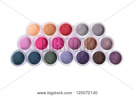 Set of bright mineral eyeshadows, top view isolated on white background