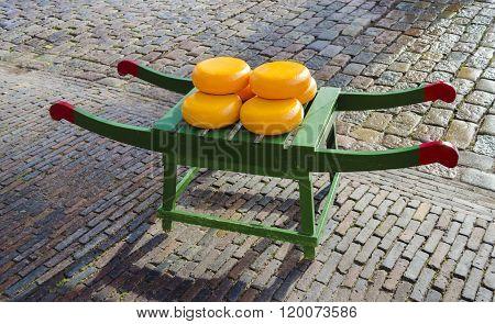 Round Dutch cheese on a Barrow