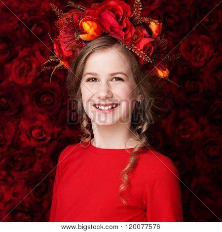 Portrait Of A Little Cute Girl In A Flower Wreath, Smiling