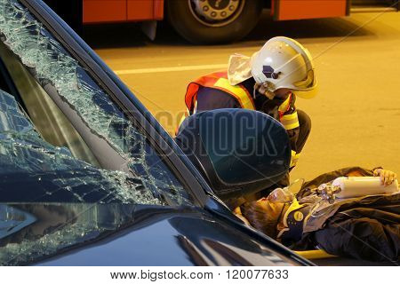 CZECH REPUBLIC, PLZEN,  30 SEPTEMBER, 2015:Brave firefighter relieve  an injured after car accident