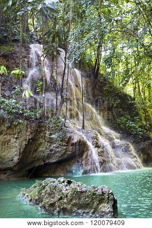 Jamaica. Small waterfalls in the jungle in a sunny day