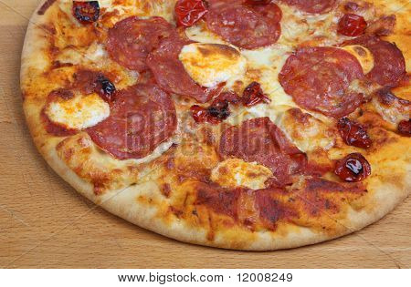 Tuscan Pizza with salami, mascapone cheese and sun-dried tomatoes