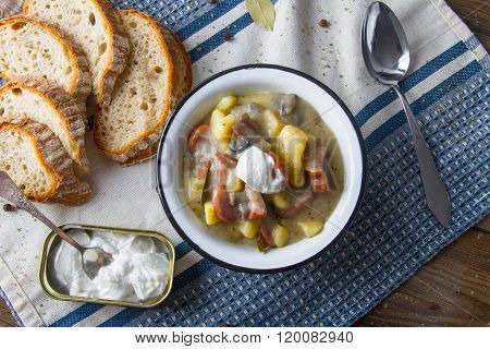 Polish sour soup with sausage and bread.