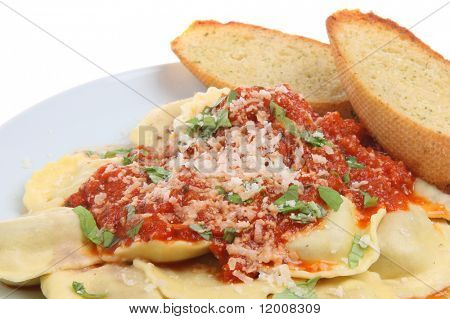Ravioli pasta with tomato sauce and garlic bread