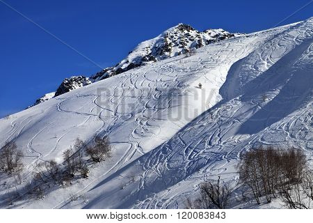 Off-piste Slope With Track From Ski And Snowboard On Sunny Day