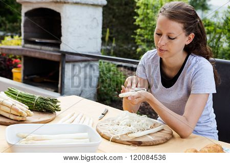 Woman With Green And White Asparagus