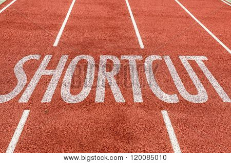 Shortcut written on running track