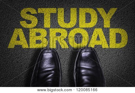 Top View of Business Shoes on the floor with the text: Study Abroad