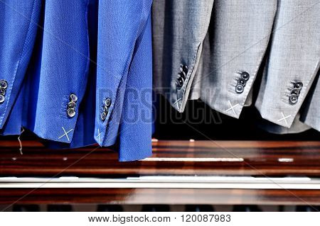 Elegant Suits In A Row Inside Suit Store