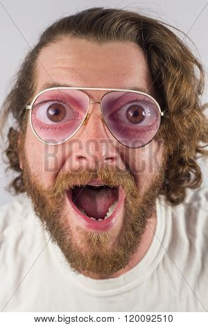 Silly surprised four eyed man wearing glasses