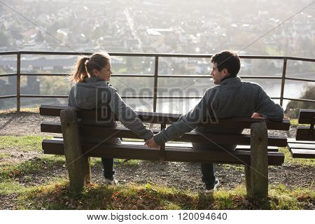 Young Couple On The River Side