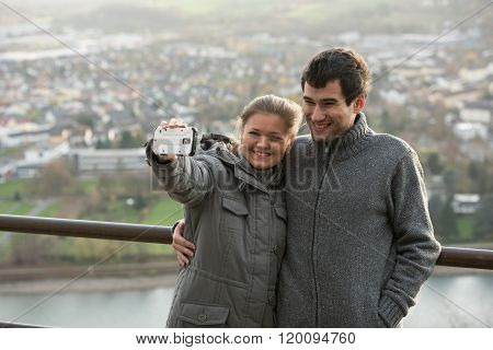 Young Couple Makes Selfie