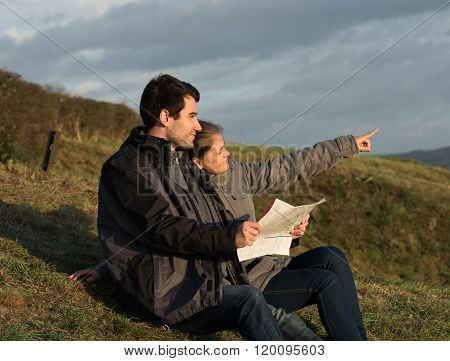 Young Couple Using Map