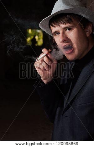 Smoking Man In A Hat