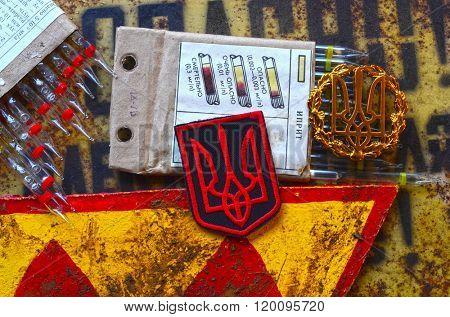 Kiev,Ukraine.FEB 20 ILLUSTRATIVE EDITORIAL.Cockade of Ukrainian Army with chemical warfare test tubes.At February 20,2016 in Kiev, Ukraine