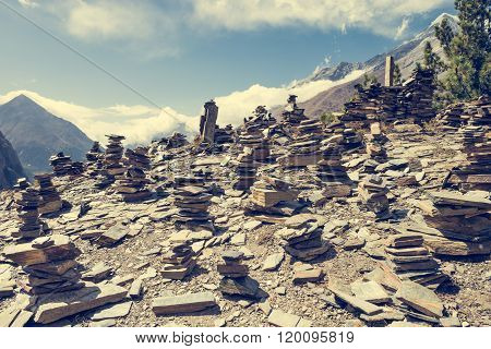 Stone piles with mountain on background.