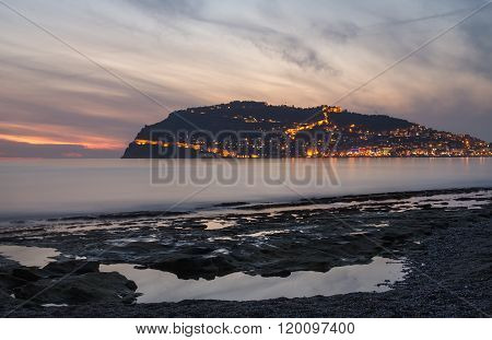 Sunset view of harbor, sea and fortress in Alanya, Turkey.