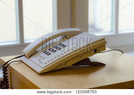 Telephone In An Office Window.
