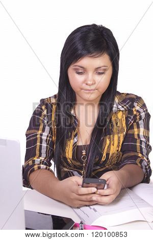 Cute Woman Studying At Her Desk Adn Texting