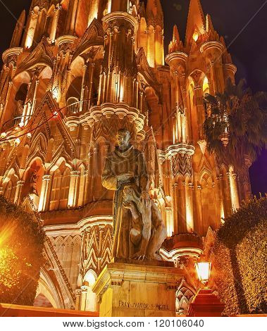 Father Juan de San Miiguel Statue Night Facade Parroquia Christmas Archangel church San Miguel de Allende Mexico. Parroaguia created in 1600s and facade created in 1880s.