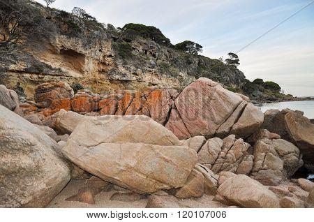 Orange Granite and Limestone Cliffs