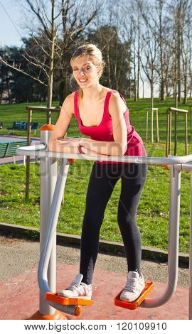 Portrait Of Cheerful Woman In Fitness Wear Exercising With Equipments On The Park