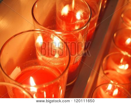 Some Red Candle Burning In A Church