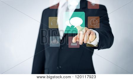 people, business, technology and communication concept - close up of man pointing finger to messenger icon projection