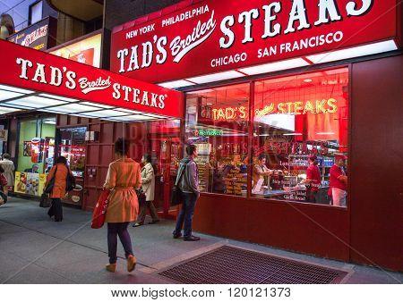 New York, U.S.A. - October 9, 2010: Manhattan, people in front of a steak house near Rockefeller Center.