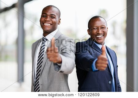 cheerful african business team giving thumbs up