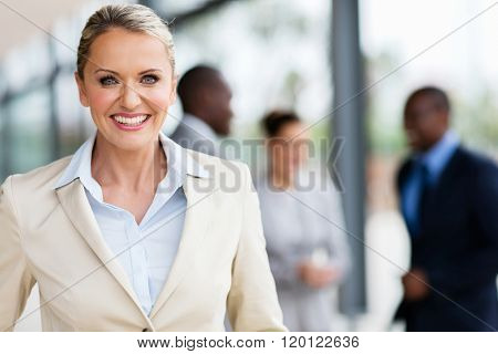 portrait of cheerful mid age business executive in office