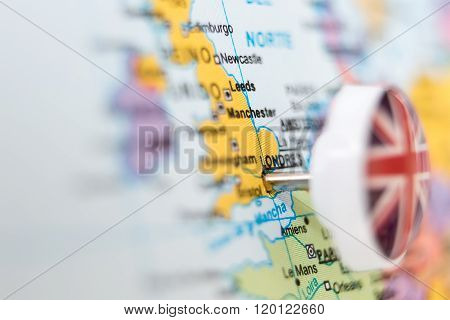 Needle With Flag Of United kingdom Stuck In Map