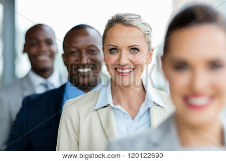 happy mid age businesswoman standing in a row with business team