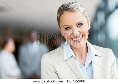 close up portrait of cheerful mid age businesswoman
