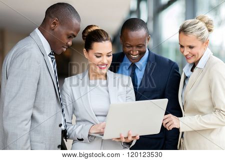 professional business people using laptop computer in office building