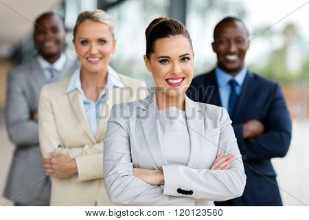 happy business woman with group of businesspeople on background