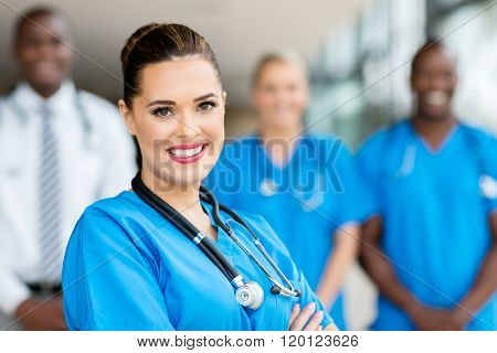 attractive young medical doctor and colleagues in hospital