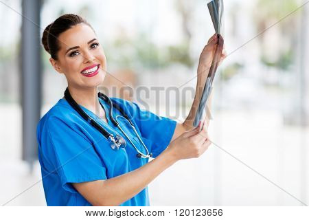 attractive young medical surgeon holding x-ray