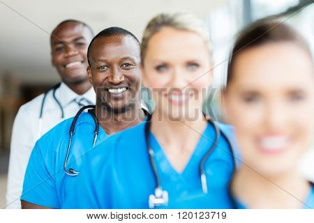 group of modern multiracial healthcare workers in a row