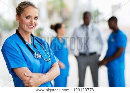 beautiful middle aged medical doctor arms crossed