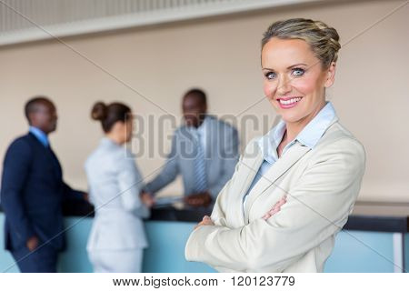 beautiful businesswoman standing at hotel reception