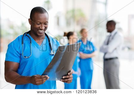 handsome african healthcare worker with x-ray