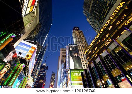 New York U.S.A. - October 9 2010: Manhattan,  night view of towers and neon sign in Times Square area.