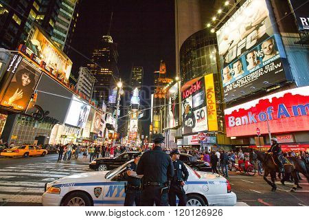New York U.S.A. - October 9 2010: Manhattan night view of  people and policemen in Times Square area.