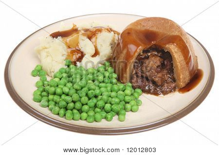 Steak & kidney pudding with mash, peas and gravy.