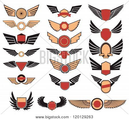Set Of The Vector Emblems With Wings