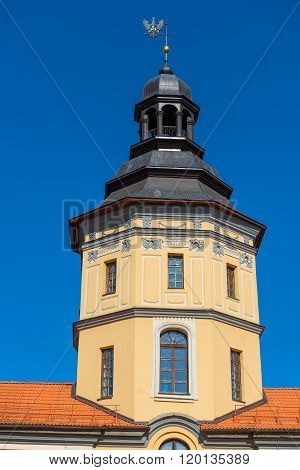 Tower Of The Castle In Nesvizh On A Background Of Blue Sky