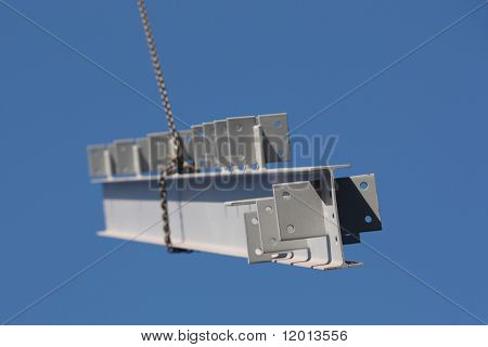 Steel girder swinging from crane